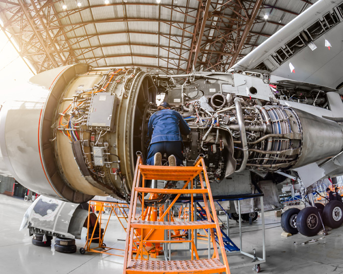 Aerospace Technician Or Engineer Working On A Spaceship