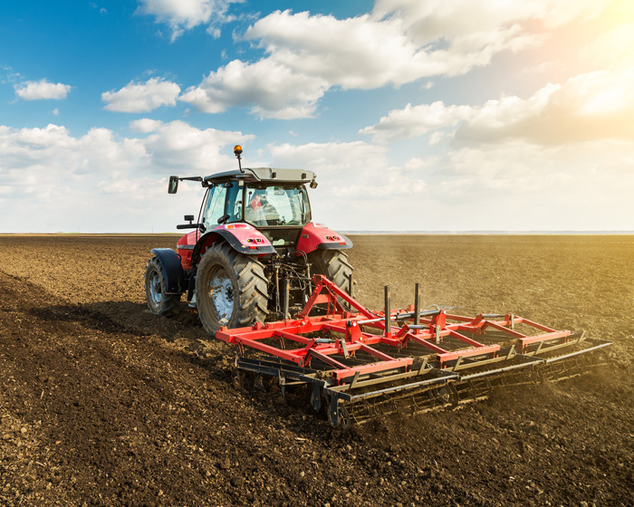 Tractor Working In A Farm Field