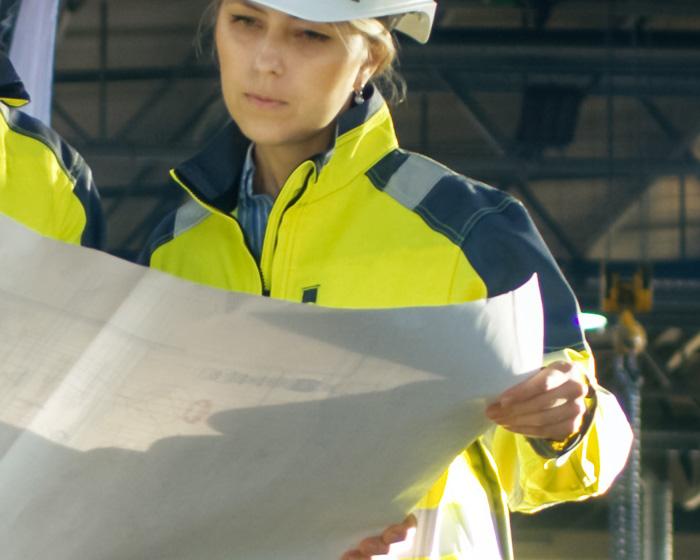 Engineer Examining A Blueprint