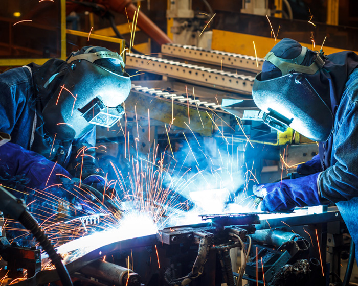 Technicians Welding In A Manufacturing Facility