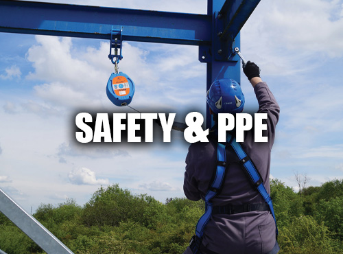 Man Working Outside Wearing A Tractel Fall Protection Harness
