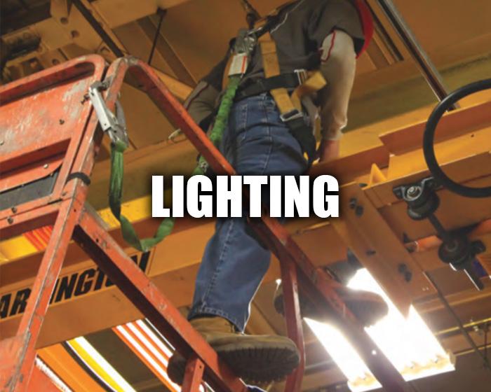 Service Tech Working Under Crane Lights