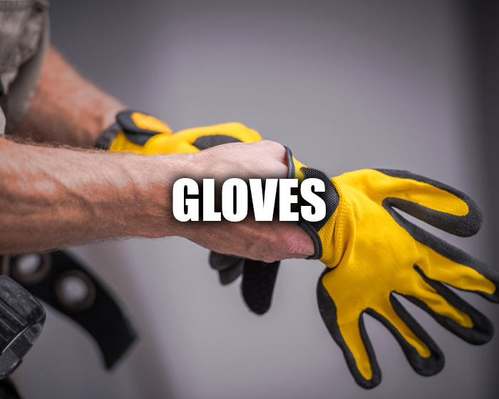Man Putting On A Yellow Pair Of Gloves