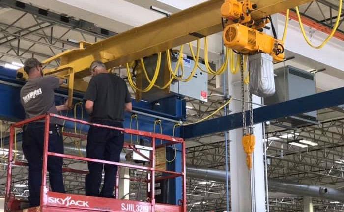 Crane Technicians Servicing An Overhead Crane