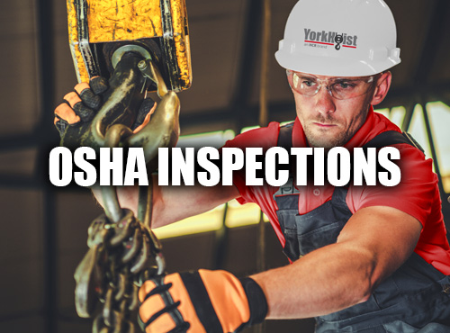 Service Technician Working On A Hoist