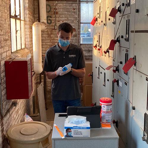Yorkhoist Employee Sanitizing A Work Area