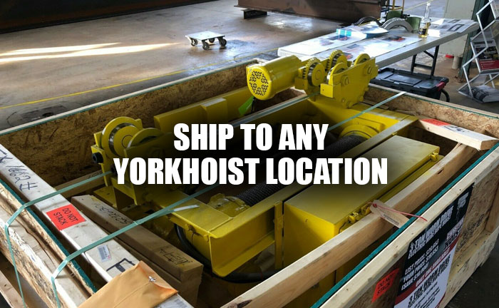 Yellow Hoist In A Shipping Crate